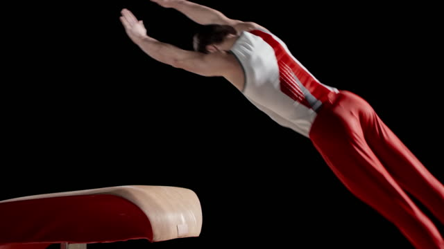 slo mo male gymnast doing his routine on the vault - gymnastics stock videos & royalty-free footage