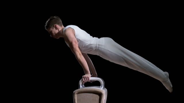 slo mo male gymnast performing a double leg circle on the pommel horse - gymnastics stock videos & royalty-free footage