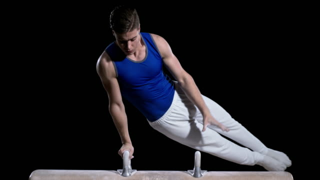 slo mo male gymnast performing a double leg circle - stunt stock videos & royalty-free footage