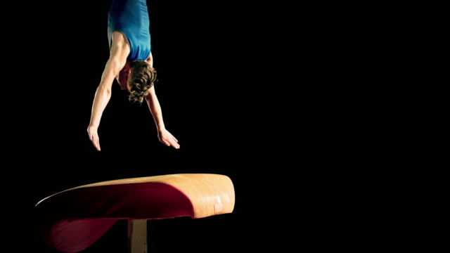 slo mo male gymnast performing a front handspring on the vault - gymnastics stock videos & royalty-free footage