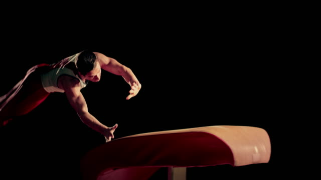 slo mo male gymnast performing his routine on the vault - gymnastics stock videos & royalty-free footage