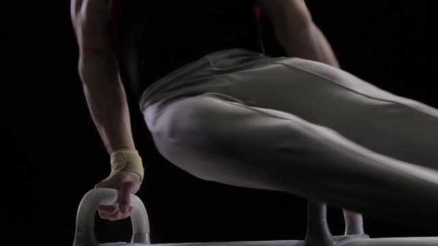 cu male gymnast performing on pommel horse / auckland,auckland,new zealand - gymnastics stock videos & royalty-free footage
