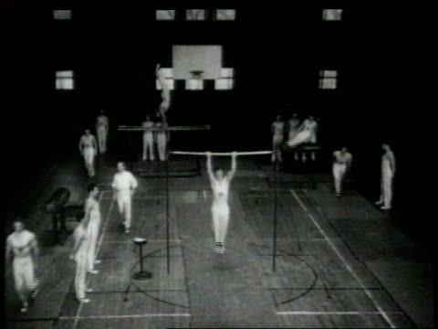 stockvideo's en b-roll-footage met 1948 montage male gymnasts in training / united states - de brug