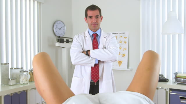 male gynecologist standing in front of woman - pregnancy test stock videos and b-roll footage