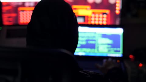 male hacker working on a computer - stealing crime stock videos & royalty-free footage