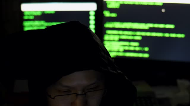 male hacker working on a computer - code talker stock videos & royalty-free footage