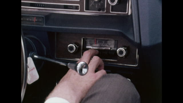 vídeos de stock e filmes b-roll de male hand changes car radio; 1972. - estilo retro