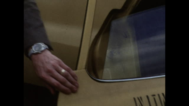 male hand closes door on yellow taxi in new york; 1971 - yellow taxi video stock e b–roll