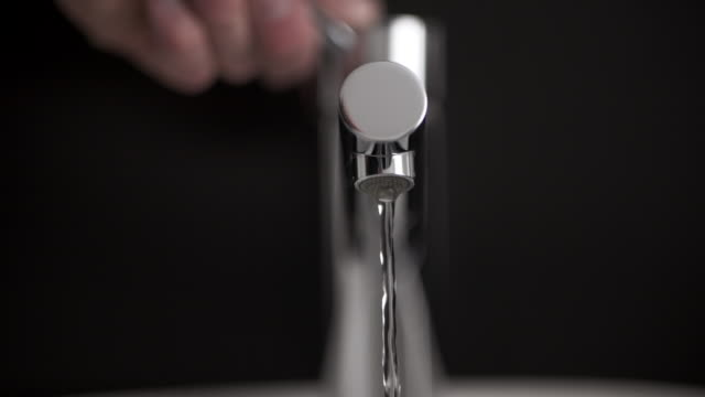 male hand closing faucet in a bathroom - sink stock videos & royalty-free footage