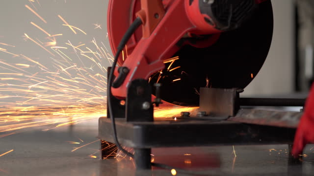 male hand cuts off pieces of steel - metal worker stock videos & royalty-free footage