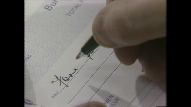 a male hand forges a cheque by changing the amount - cheque financial item stock videos & royalty-free footage
