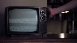 Male Hand hitting an Old Broken TV with Green Screen.