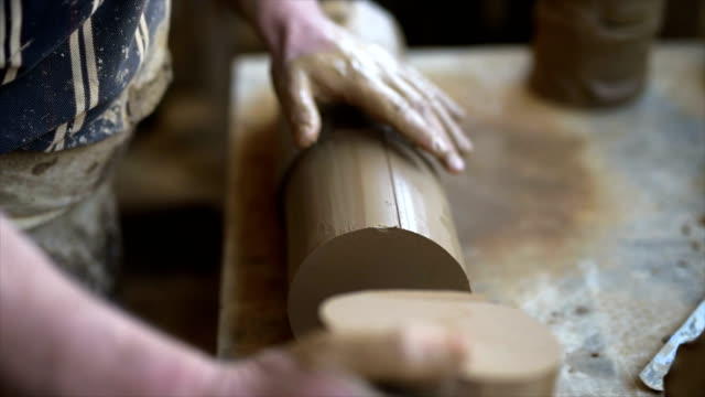 male hand of pottery master preparation clay for pottery wheel. - one mature man only stock videos & royalty-free footage