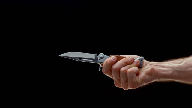slo mo ld male hand opening a spring assisted knife - knife crime stock videos & royalty-free footage