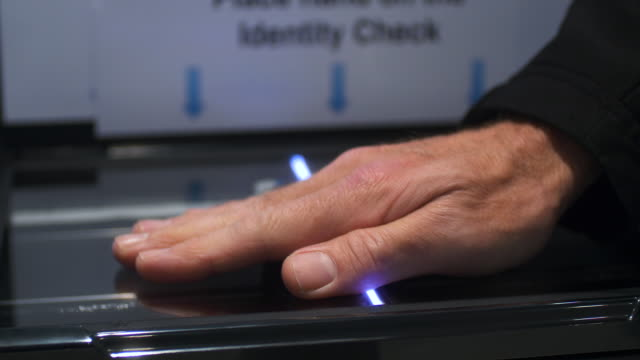 male hand placed on hand scanner. security check. - identity stock videos & royalty-free footage