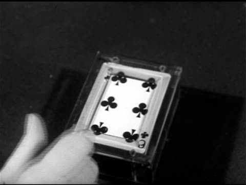 male hand placing 'dealer's box' on table, finger taping six of clubs on top, demonstrating single pull out, 'jack o'diamonds' saying designed for... - hand of cards stock videos & royalty-free footage