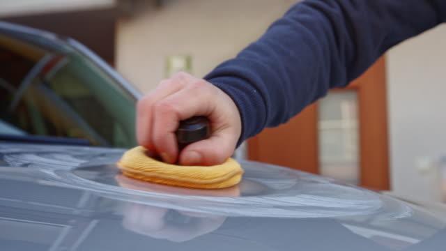 male hand polishing a silver car - polishing stock videos & royalty-free footage