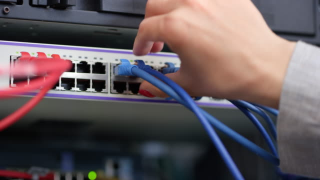 ld male hand pulling patch cables out of the server - computer cable stock videos and b-roll footage