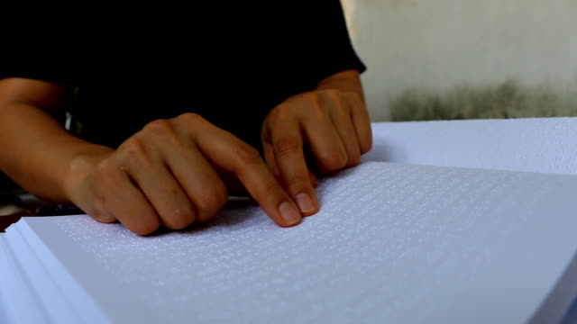 male hand reading braille dot language for the blind - braille stock videos & royalty-free footage