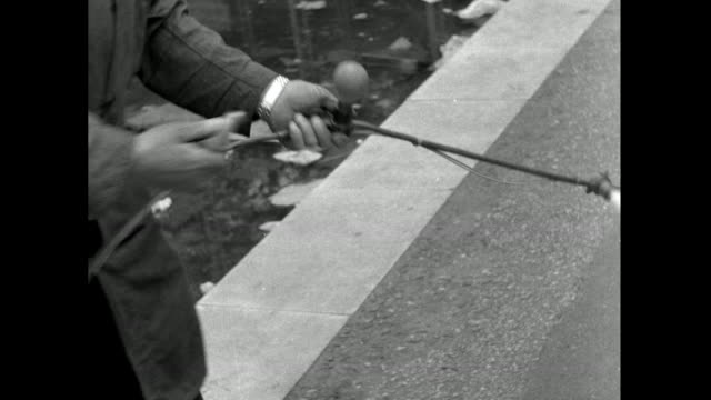 male hand removing light bulbs from outdoor string lights; 1953 - 1953 stock videos & royalty-free footage