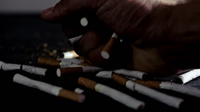 slo mo male hand smashing cigarettes - negatives stock videos & royalty-free footage