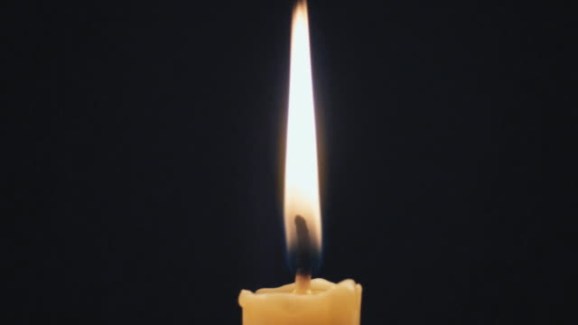 stockvideo's en b-roll-footage met slo mo ecu male hand snuffing out candle / auckland, new zealand - candlelight