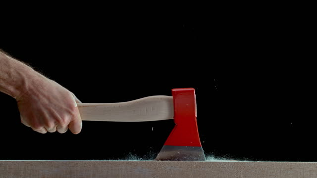 slo mo ld male hand swinging a hatchet into the table - axe stock videos & royalty-free footage