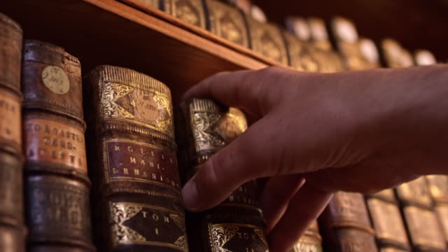 ds male hand taking an old book from the shelf - unfashionable stock videos & royalty-free footage