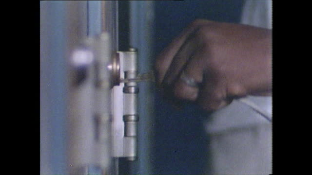 male hand unlocks a series of prison cell doors - jail cell stock videos & royalty-free footage