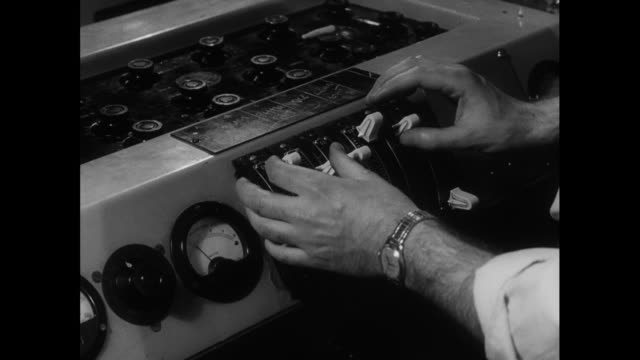 male hand uses switches and dials; 1963 - anno 1963 video stock e b–roll