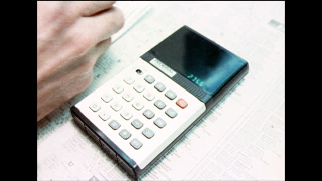 vídeos y material grabado en eventos de stock de cu of male hand using pocket calculator; 1978 - símbolo matemático