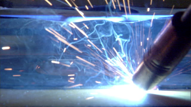 male hand using small welding torch, heating base edge of raised numbers, blue white hot, sparks, smoke. welding. torch going out, red hot metal... - roman numeral stock videos & royalty-free footage