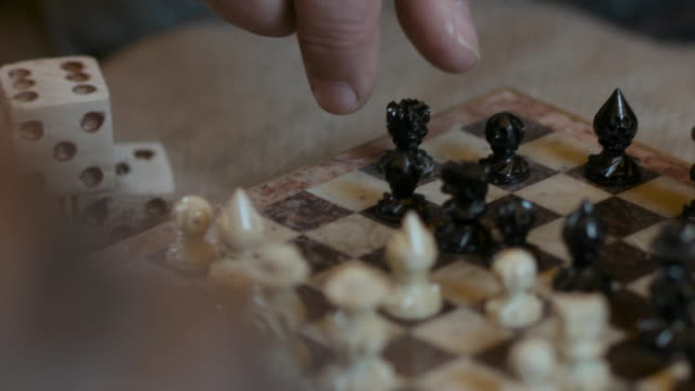 male hands move chess pieces on board - loss stock videos & royalty-free footage