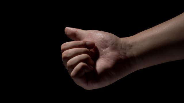 male hands on a black background - arm stock videos & royalty-free footage