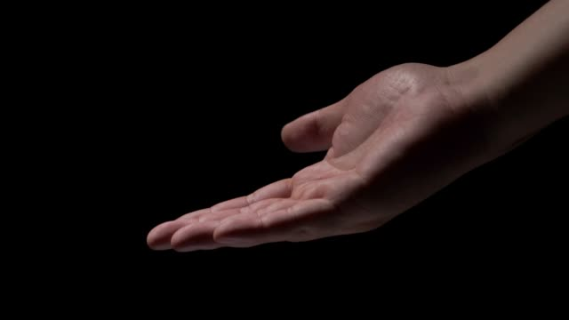 male hands on a black background - palm stock videos & royalty-free footage