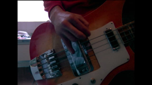 ms of male hands playing red and orange guitar; 1982 - one teenage boy only stock videos & royalty-free footage