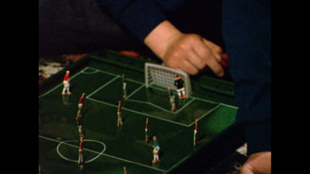 cu of male hands playing toy football game; 1969 - goalkeeper stock videos & royalty-free footage