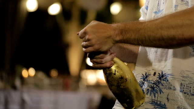 male hands uncorking a bottle of champagne wine. - champagne stock videos & royalty-free footage