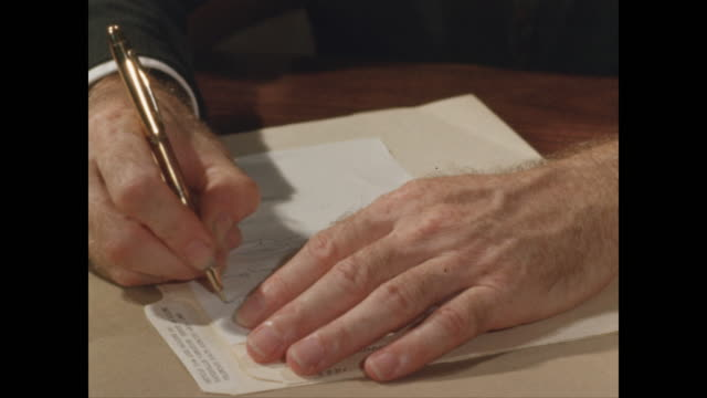cu male hands writing with pen and paper - pen stock videos & royalty-free footage
