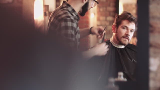 male having haircut in barbershop - beauty salon stock videos and b-roll footage