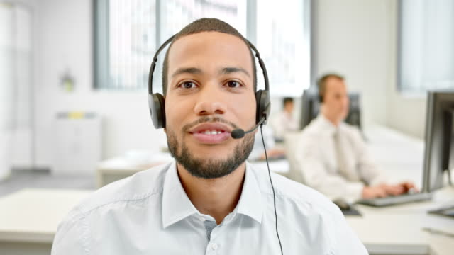 ld male helpline operator on video call with customer - headset stock videos & royalty-free footage