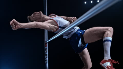 slo mo male high jumper jumping over the bar - sportsperson stock videos & royalty-free footage