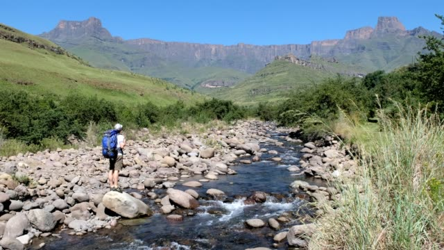 male hiker admires the view over the tugela river - kwazulu natal stock videos & royalty-free footage