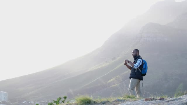 male hiker admiring the view of the mountains - national park stock videos & royalty-free footage