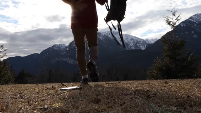 male hiker drops phone on ridge crest, in meadow - remote location phone stock videos & royalty-free footage