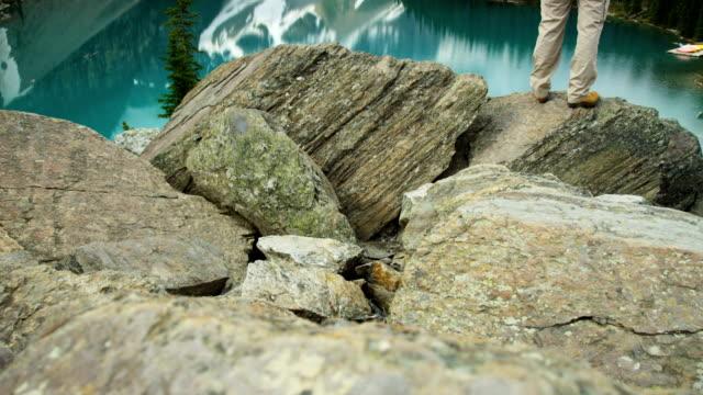 male hiker enjoying majestic scenery lake moraine canada - red lake stock videos & royalty-free footage