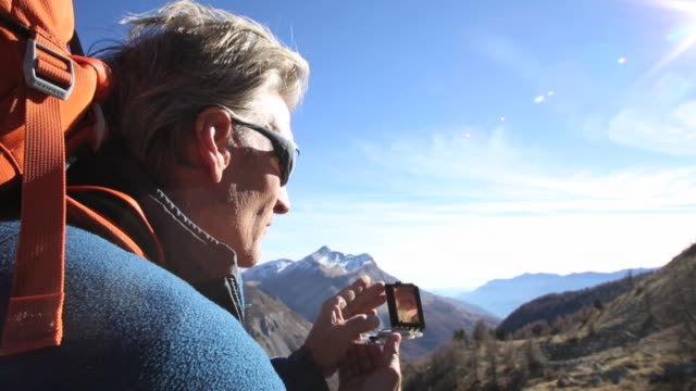 male hiker takes compass reading to route ahead - guidance stock videos & royalty-free footage