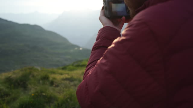 male hiker takes picture with slr camera - slr camera stock videos and b-roll footage
