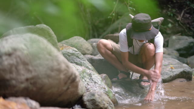 male hiker washing his hand with river water - recreational pursuit stock videos & royalty-free footage