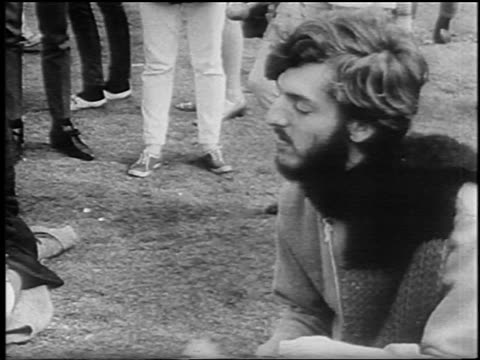 profile male hippie with eyes closed sitting on ground at bein / seattle / newsreel - 1967 stock videos & royalty-free footage